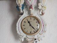 Porzelanfigur mit Uhr - Fuldatal