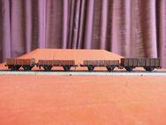 Modelleisenbahn Spur H0 / Express Trix 4 rotbraune offene Güterwagen - Waggons - Zeuthen