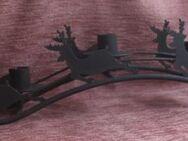 Metallener schwarzer Rentierschlitten als Adventskranz - Bad Belzig
