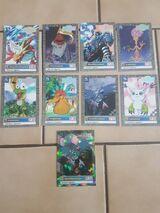 """9 Digimon Karten. Eine """"Holo"""" dabei."""
